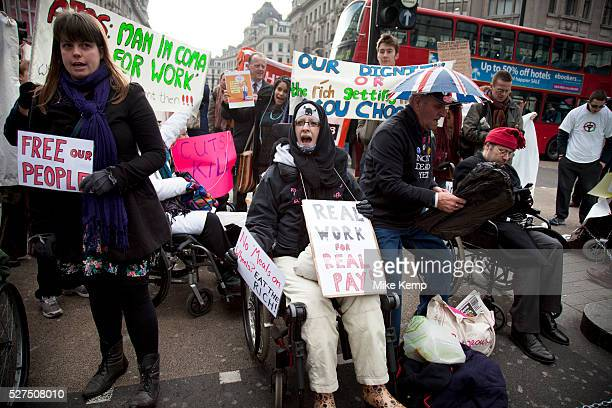 Disabled and able bodied demonstrators chain themselves together and block Oxford Circus in central London Protesting at the Tory parties Welfare...