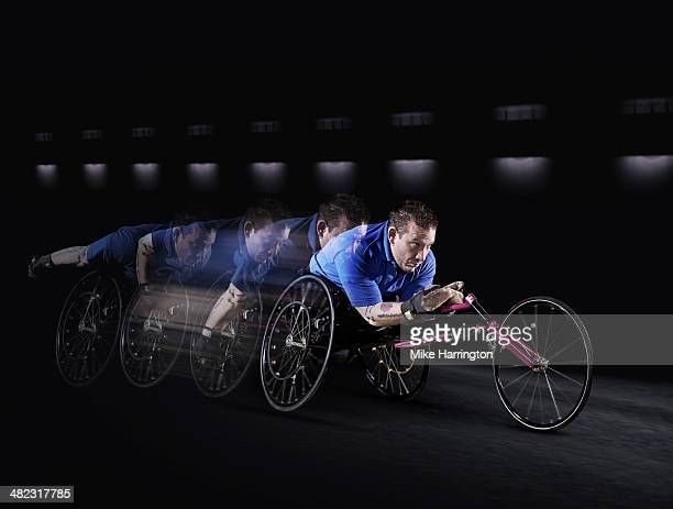 Disabled athlete racing in wheelchair.