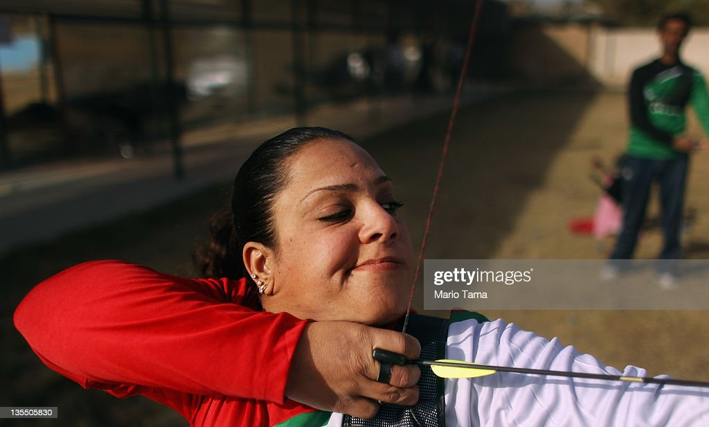 Disabled athlete Rana Alawi practices archery while training for the Paralympic team at the Al Thura Sports Handicapped Club located in the Al Thura Disabled Veteran's Community on December 11, 2011 in Baghdad, Iraq. Alawi has been disabled since the age of seven when she received a faulty injectionIraq's health care system remains in shambles following two decades of war and economic sanctions. Iraq is transitioning nearly nine years after the 2003 U.S. invasion and subsequent occupation. American forces are now in the midst of the final stage of withdrawal from the war-torn country. At least 4,485 U.S. military personnel have died in service in Iraq. According to the Iraq Body Count, more than 100,000 Iraqi civilians have died from war-related violence.