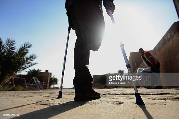 Disabled athlete Saad Hussein who said he was wounded by an American bomb in January stands in the Al Thura Disabled Veteran's Community while on his...