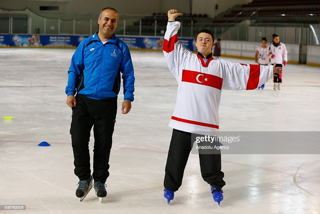 A disabled boy tries to learn ice skateing at Bornova Amphitheatre Ask Veysel Recreation Area in Izmir, Turkey on May 26, 2016. Bornova Amphitheatre Ask Veysel Recreation Area is open every thursday for disabled people.