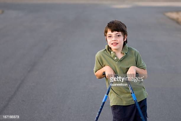 Disabled boy with canes