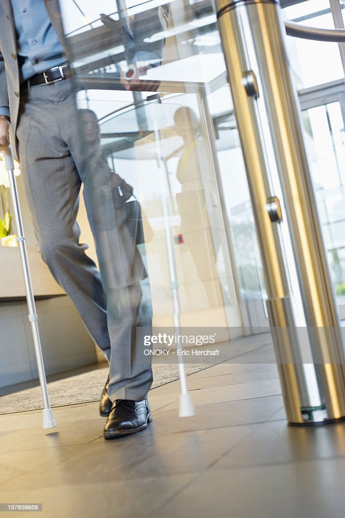 Disabled businessman entering the office