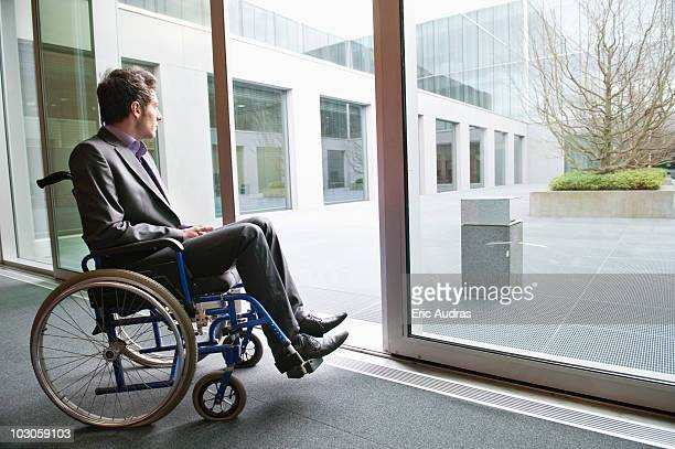Disabled businessman sitting in a wheelchair