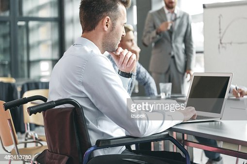 Disabled businessman working in an office