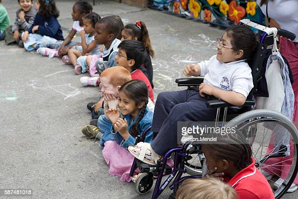 A disabled child at participates in a game in her wheelchair along with the other able bodied children during a special pupils picnic held at...