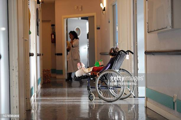 A disabled child is in his wheel chair in a corridor at the physiotherapy center of Garches hospital a Paris suburb on December 15 2010 Carla...