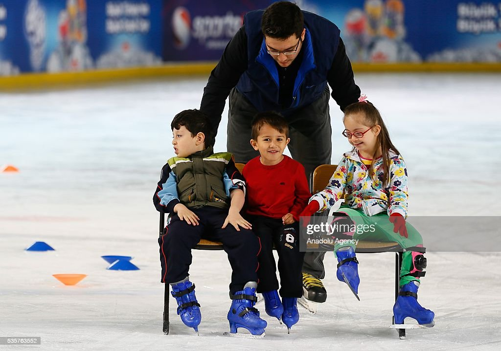 Disabled children try to learn ice skating at Bornova Amphitheatre Ask Veysel Recreation Area in Izmir, Turkey on May 26, 2016. Bornova Amphitheatre Ask Veysel Recreation Area is open every thursday for disabled people.