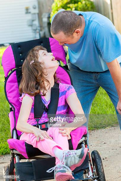 Disabled girl looks up at her Daddy