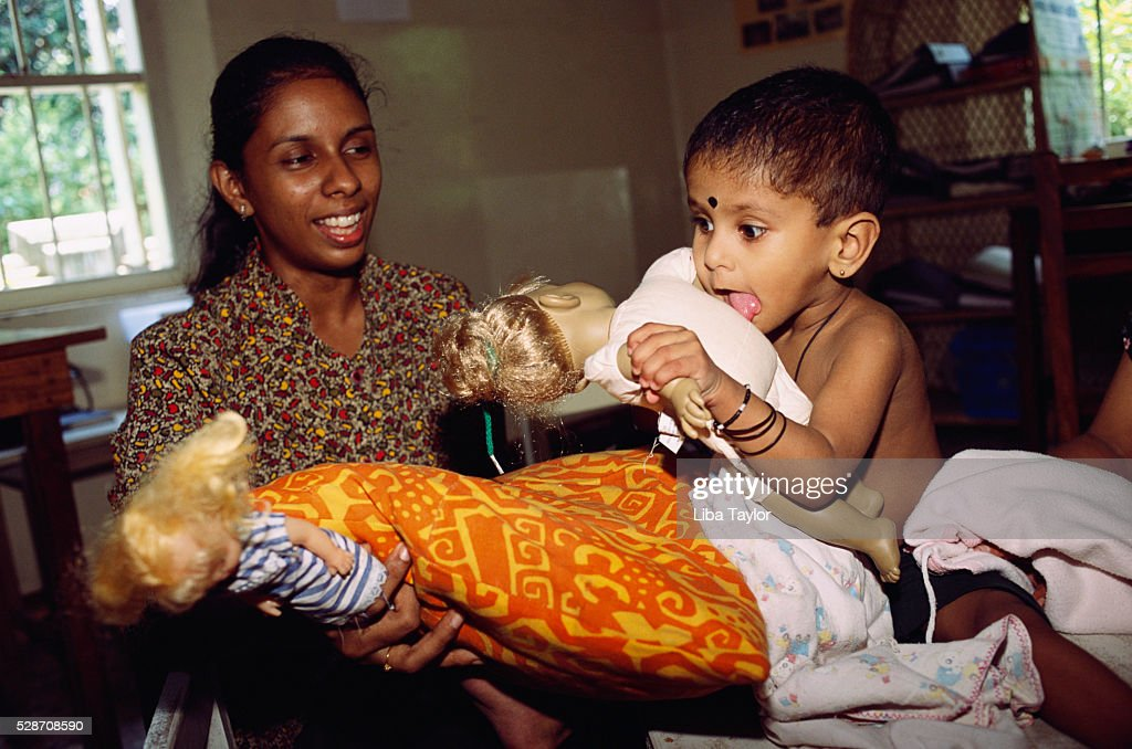 Disabled Girl Receives Physiotherapy