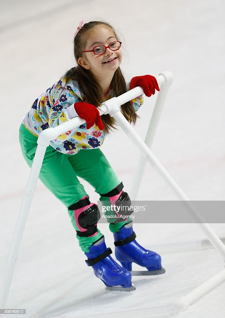 A disabled girl tries to learn ice skating at Bornova Amphitheatre Ask Veysel Recreation Area in Izmir, Turkey on May 26, 2016. Bornova Amphitheatre Ask Veysel Recreation Area is open every thursday for disabled people.