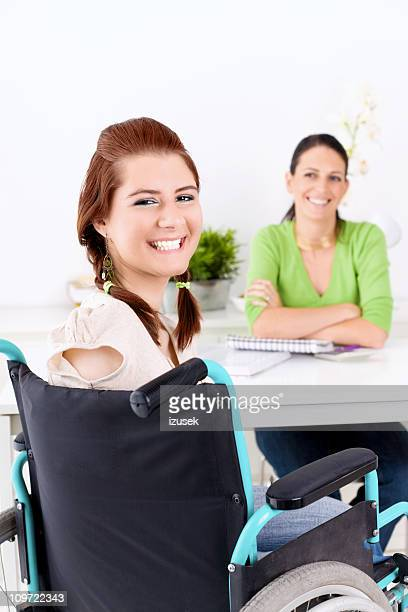 Disabled Girl With Her Health Advisor