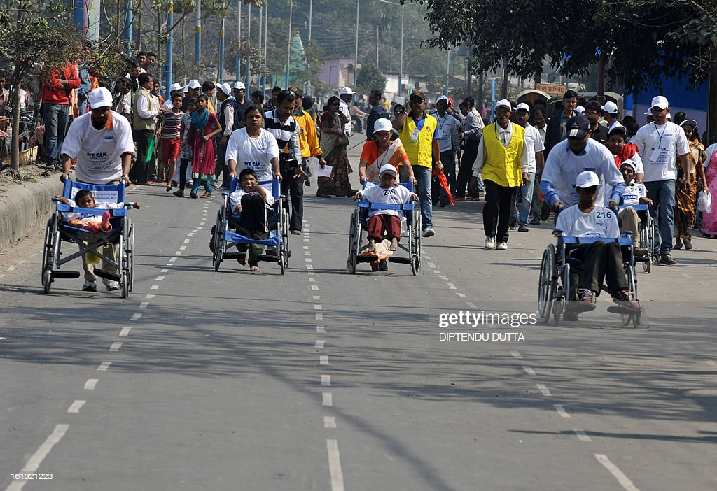Disabled Indian children compete in a wheelchair race in Siliguri on February 10, 2013. Some 84 mentally and physically disabled children from West Bengal state took part in the event organised by charitable organisation Anubhab. AFP PHOTO/Diptendu DUTTA