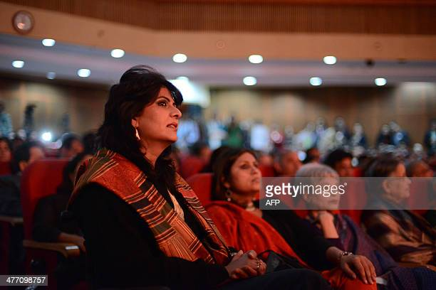 Disabled Indian sportswoman Deepa Malik looks on as she attends an awards ceremony in New Delhi on March 6 2014 Malik who is a paraplegic combines...