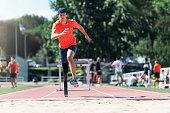 Disabled man athlete jumping with leg prosthesis. Paralympic Sport Concept.