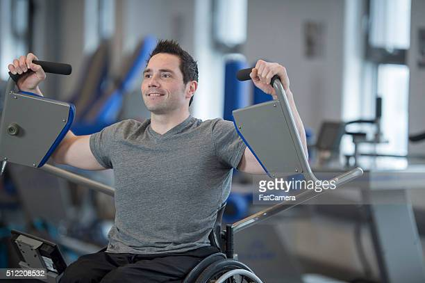 Disabled Man Happily Working Out at the Gym