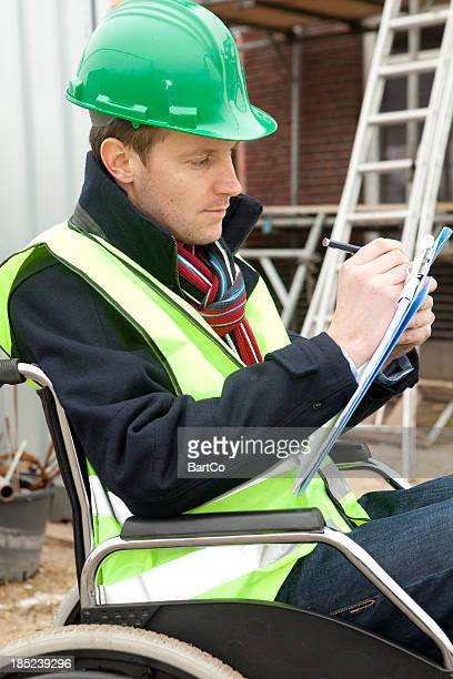 Disabled man in wheelchair working hard