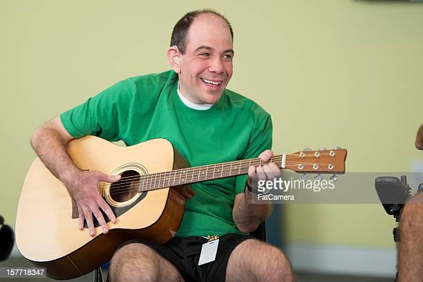 Disabled man playing guitar