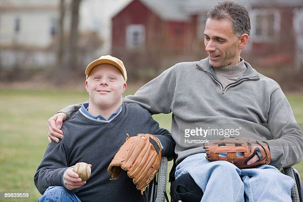Disabled man smiling with his son