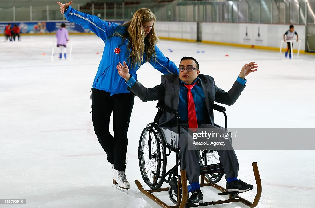 A disabled man tries to learn ice skating at Bornova Amphitheatre Ask Veysel Recreation Area in Izmir, Turkey on May 26, 2016. Bornova Amphitheatre Ask Veysel Recreation Area is open every thursday for disabled people.