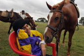 Disabled Mayank Doulani attends a therapeutic horse riding session at the Army Service Corps Center in Bangalore on August 25 2009 Equine therapist...