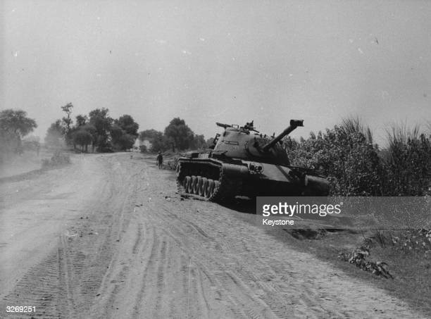 A disabled Pakistani tank lying by the roadside in the Bahara sector during the IndiaPakistan conflict