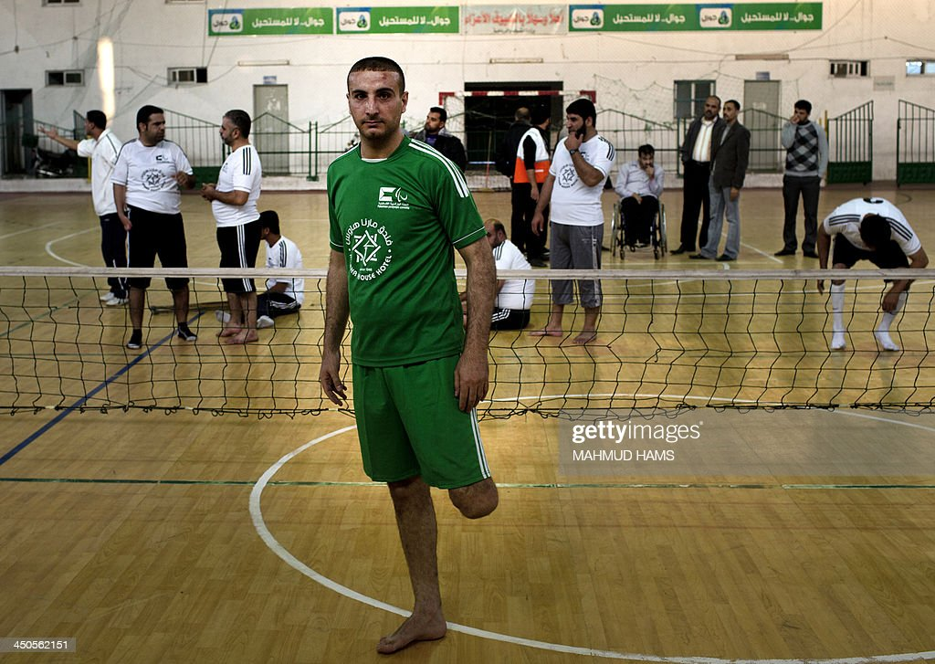 Disabled Palestinian volleyball player Hani Abu al-Aish stands prior to a game in Gaza City on November 19, 2013. Disabled players from the Islamic Society and the Red Crescent team most of them badly injured during Israel's assault on the Gaza Strip on November 14, 2012 played against eachothers marking the first anniversary of the war.