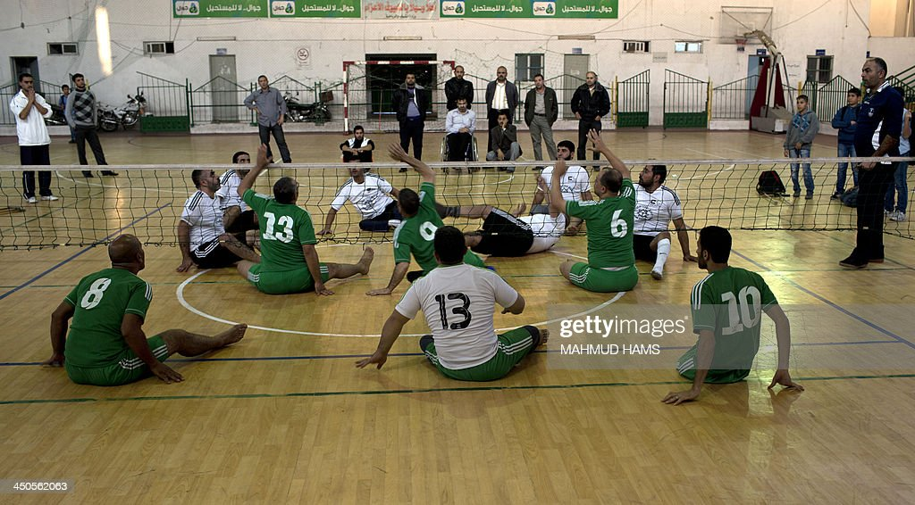 Disabled Palestinian volleyball players from the Islamic Society (foreground) and the Red Crescent, take part in a game in Gaza City on November 19, 2013. Disabled players, most of them badly injured during Israel's assault on the Gaza Strip on November 14, 2012 played a game as they marked the first anniversary of the war.