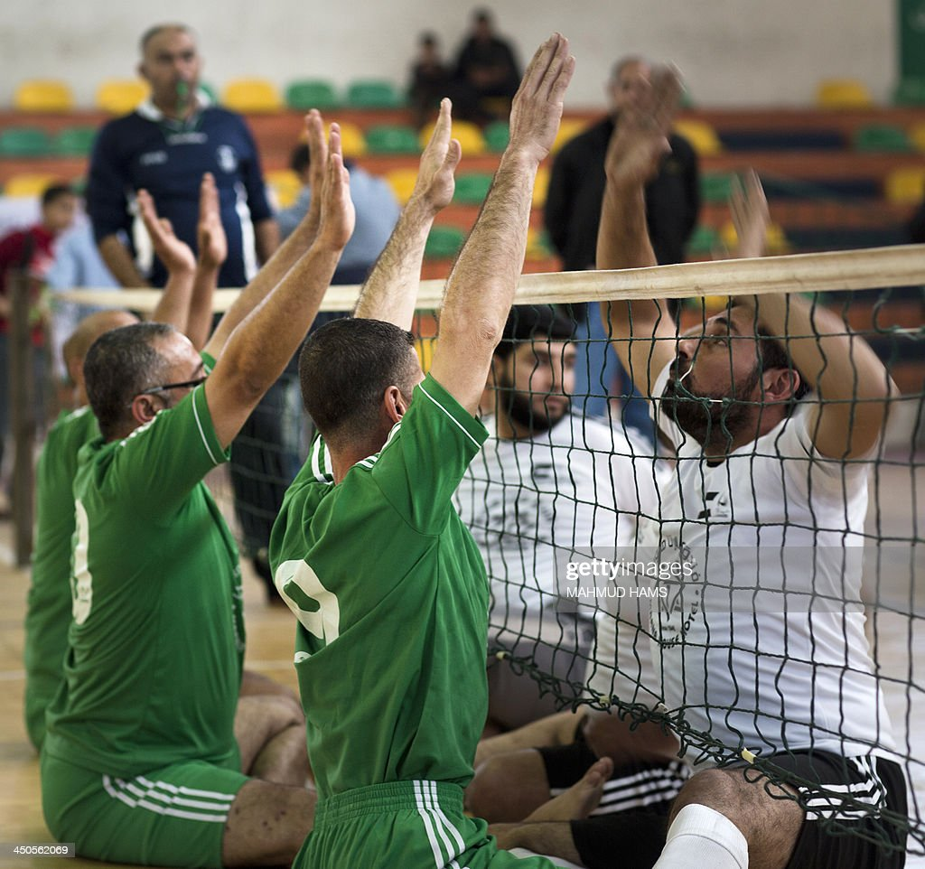 Disabled Palestinian volleyball players from the Islamic Society (L) and the Red Crescent, take part in a game in Gaza City on November 19, 2013. Disabled players, most of them badly injured during Israel's assault on the Gaza Strip on November 14, 2012 played a game as they marked the first anniversary of the war.