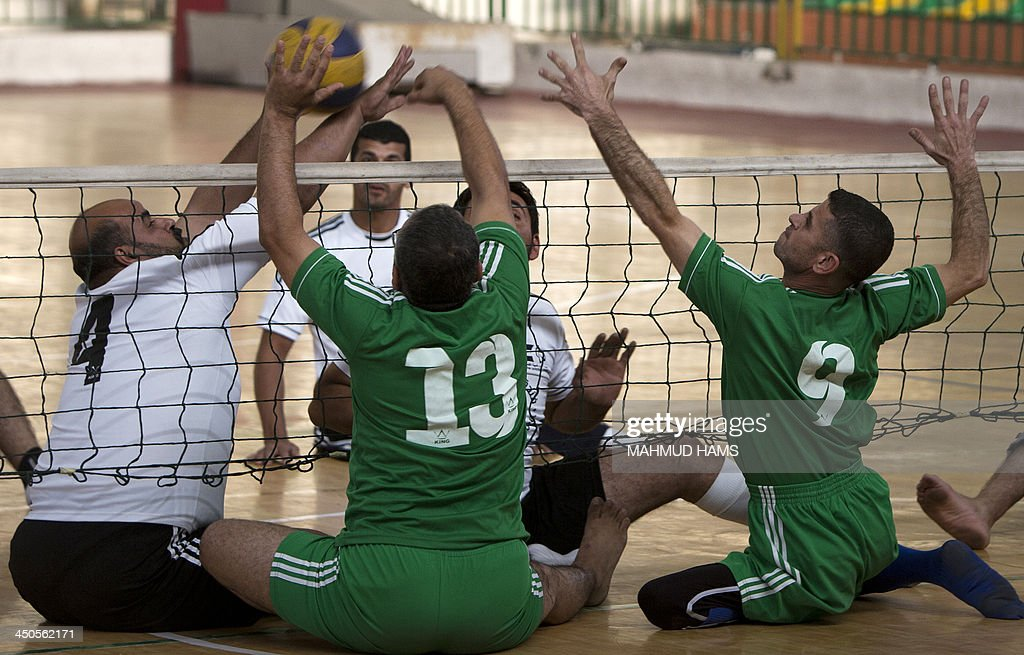 Disabled Palestinian volleyball players from the Islamic Society (R) and the Red Crescent, take part in a game in Gaza City on November 19, 2013. Disabled players, most of them badly injured during Israel's assault on the Gaza Strip on November 14, 2012 played a game as they marked the first anniversary of the war.