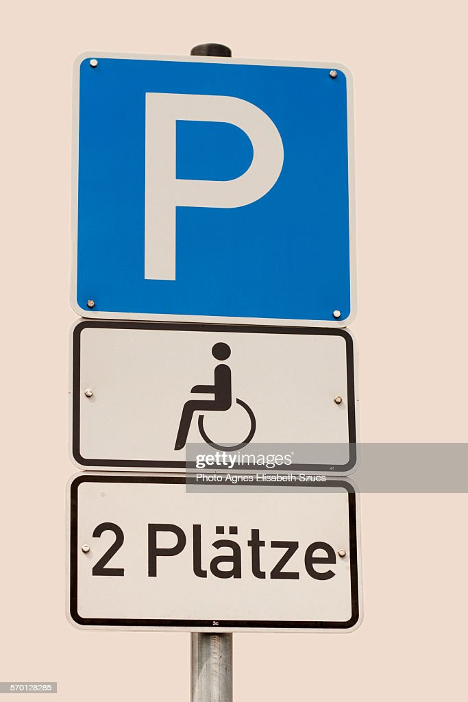 Disabled parking sign indicating 2 spaces