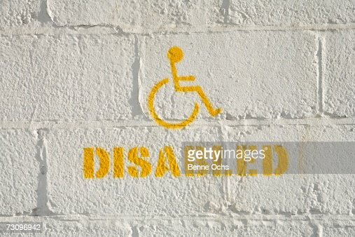 Disabled parking sign on a brick wall