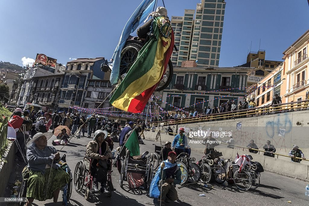 Disabled people, attending a protest, hung themselves from a bridge with their wheelchairs in La Paz, Bolivia on May 4, 2016. Protesters demand an increase in state benefits for those with disabilities during protest.