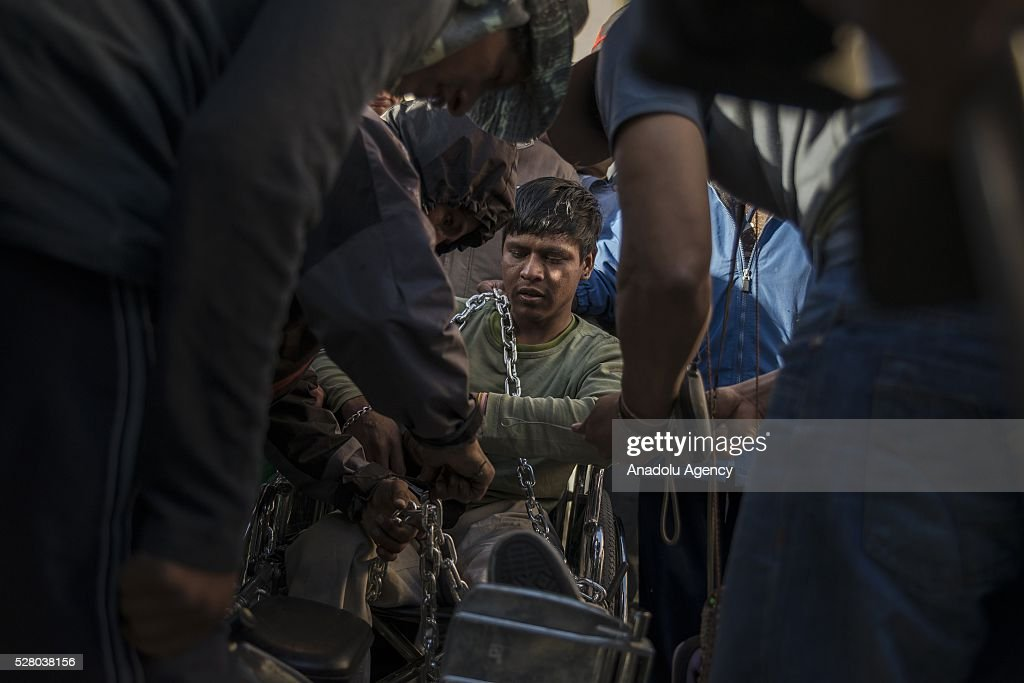 Disabled people, prepare a protest, hung themselves from a bridge with their wheelchairs in La Paz, Bolivia on May 4, 2016. Protesters demand an increase in state benefits for those with disabilities during protest.