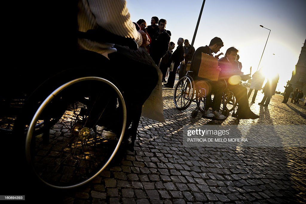 Disabled people take part in a protest in front of the Portuguese Finance Ministry in Lisbon on February 7, 2013. A group of disabled people gathered outside the Finance Ministry today to protest against tax rise and to demand an increase of their pensions and higher tax deductions.