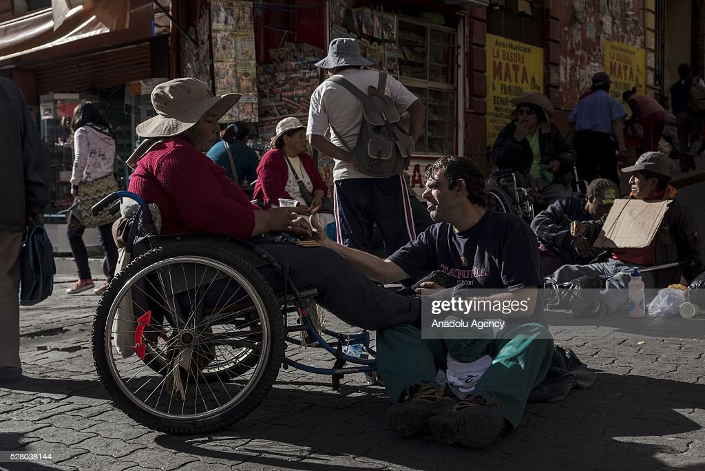 Disabled people talk to each other during a protest in La Paz, Bolivia on May 4, 2016. Protesters demand an increase in state benefits for those with disabilities during protest.