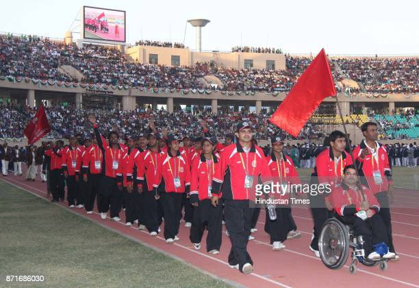 A disabled persom leading Chatishgadh team march past during the inaugural function of 34th National Game at Birsa Munda Athletic Stadium Hotwar in...