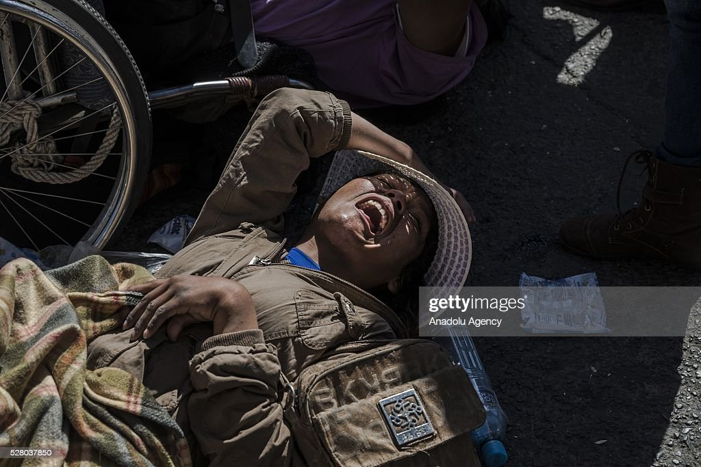 A disabled person attends a protest in La Paz, Bolivia on May 4, 2016. Protesters demand an increase in state benefits for those with disabilities during protest.