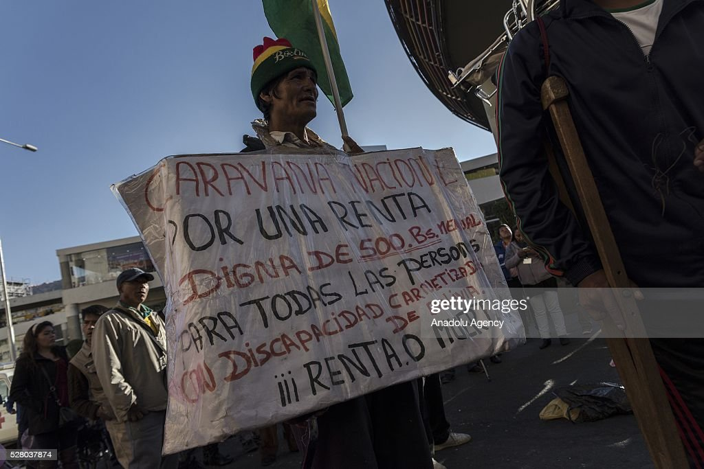 A disabled person holds banner during a protest in La Paz, Bolivia on May 4, 2016. Protesters demand an increase in state benefits for those with disabilities during protest.