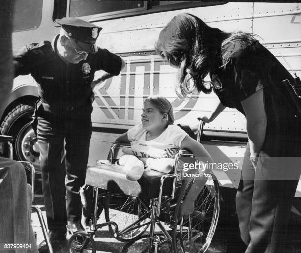 Disabled Persons Stop Buses In Demonstration Against Alleged Discrimination Police Patrolman K A Wilkinson left and Policewoman H A Rodriguez right...