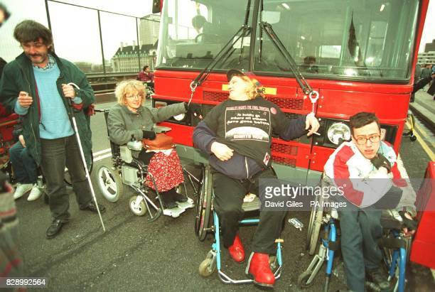 Disabled rights demonstrators chain themselves to a double decker bus on London's Westminster Bridge The action coincided with a mass lobby of...
