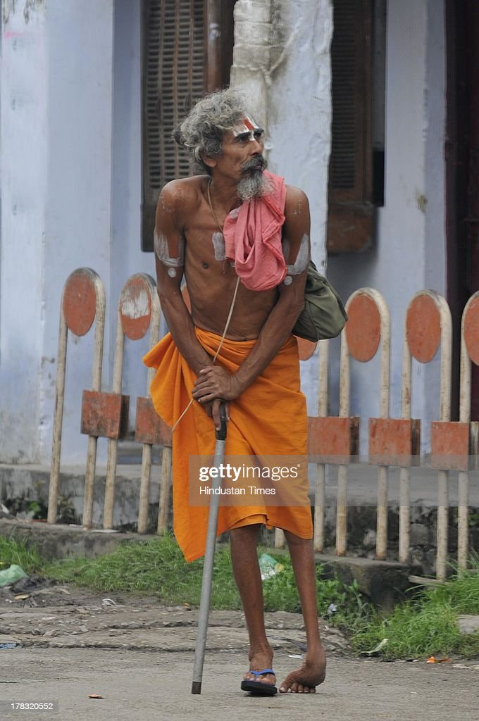 A disabled sadhu walks towards temple to offer prayers on August 28, 2013 in Ayodhya, India. Three days after Vishwa Hindu Parishad (VHP) field Parikarma attempt, Ayodhya saw a heavy presence of security personnel amid Janmashtmi celebrations. old man