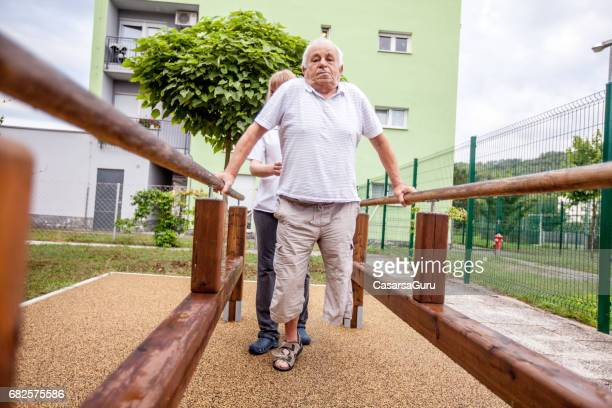 Disabled Senior Man Exercising Outdoors in Retirement Community