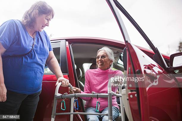 Disabled Senior Woman Getting a Ride