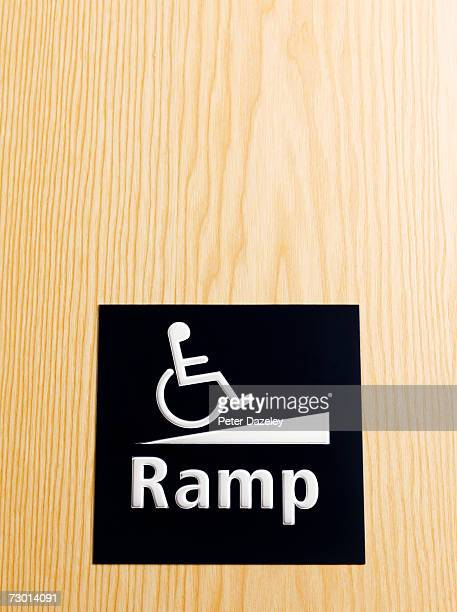 Disabled sign on door, close-up