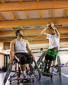 disabled sport men in action while playing indoor basketball at a basketball court