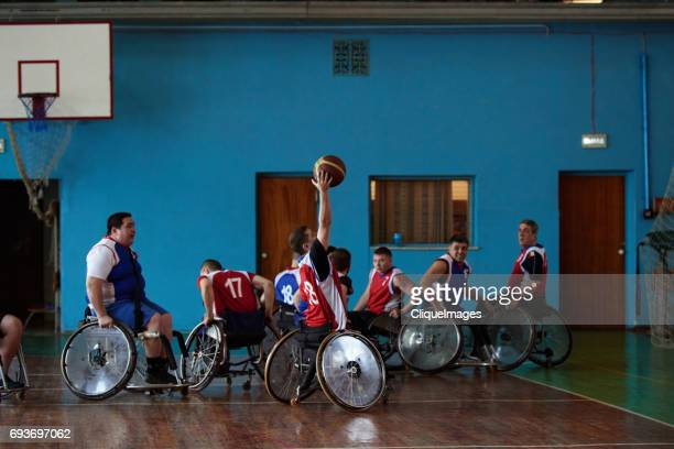 Disabled sportsmen playing basketball