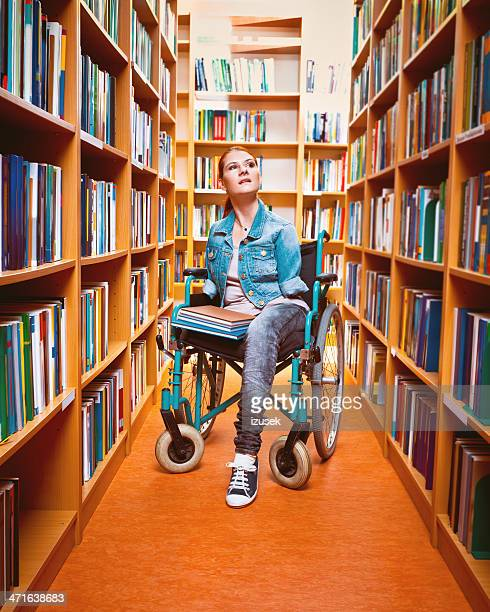 Disabled student using a library