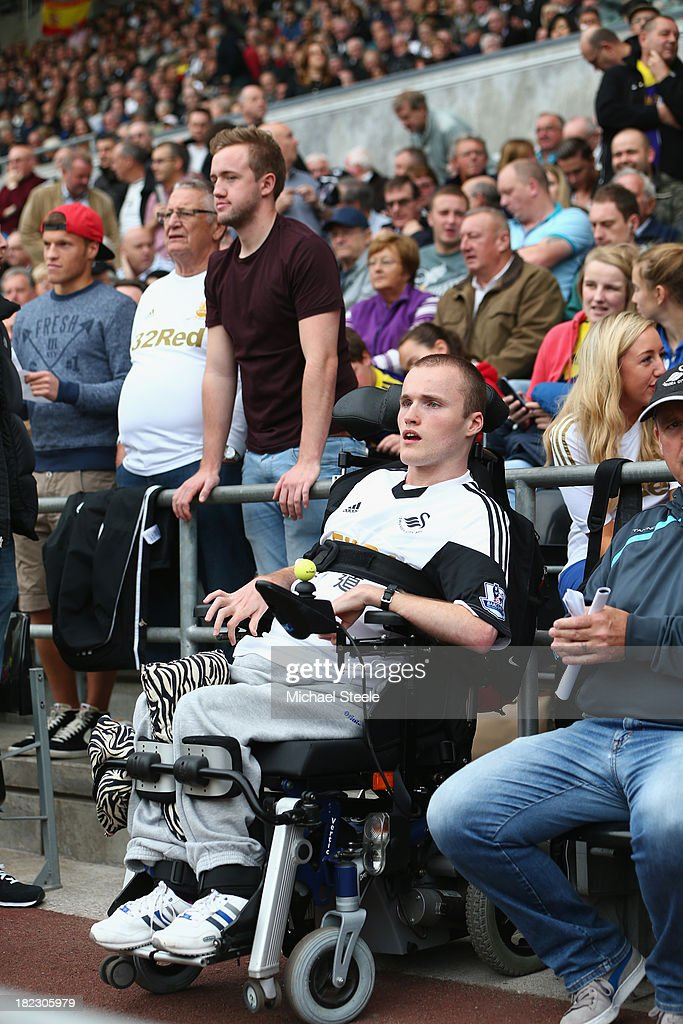 Disabled supporters of Swansea City look on during the Barclays Premier League match between Swansea City and Arsenal at the Liberty Stadium on September 28, 2013 in Swansea, Wales.