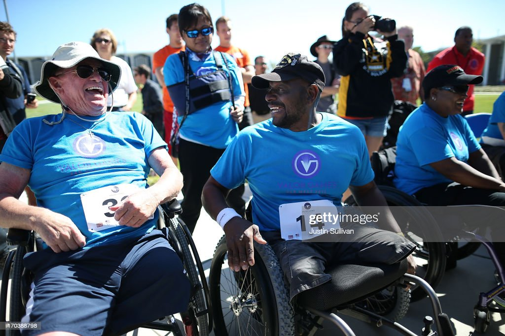 Disabled U.S. Navy veteran John Grimm (L) and disabled U.S. Army veteran Johnnie Alexander (R) share a laugh after lifting in the power lifting competition during day two of the inaugural Valor Games Far West at the College of San Mateo on June 12, 2013 in San Mateo, California. Dozens of disabled and wounded military veterans are participating in the inaugural 3-day Valor Games Far West that is open to any Veteran with a disability who is eligible for VA healthcare. The event is intended to introduce adapted sports to attendees.